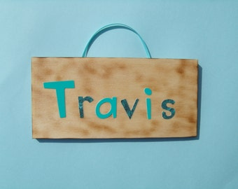 Travis name sign
