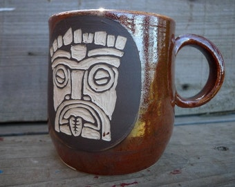 Handmade stoneware tiki sgraffito mug