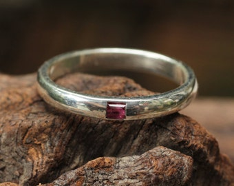 Ruby engagement ring with  silver band