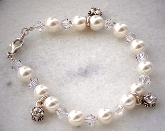 Swarovski crystal 8mm white pearl and sterling silver charm bracelet