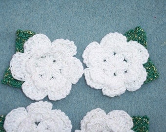 4 white crochet applique roses with attached leaves  --  1406