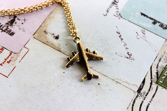 in flight. airplane necklace. gold tone