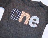 Boys ONE Shirt for First Birthday - Short sleeve dark heather gray shirt with navy polkadot orange chevron and light blue argyle