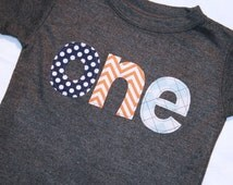Boys ONE Shirt for First Birthday - Short sleeve dark heather gray shirt with navy polkadot orange chevron and light blue argyle