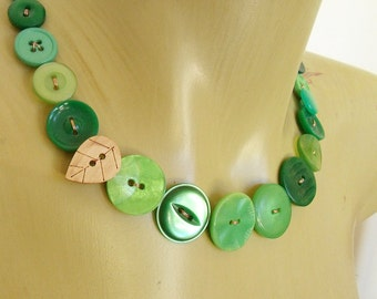 Necklace of green vintage buttons with wooden leaf