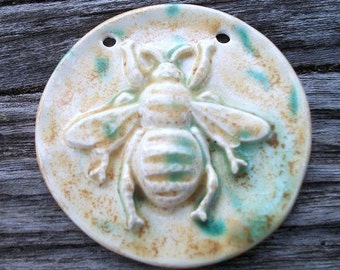 Handmade Ceramic Bee Pendant is Shades of Beige and Green Bursts