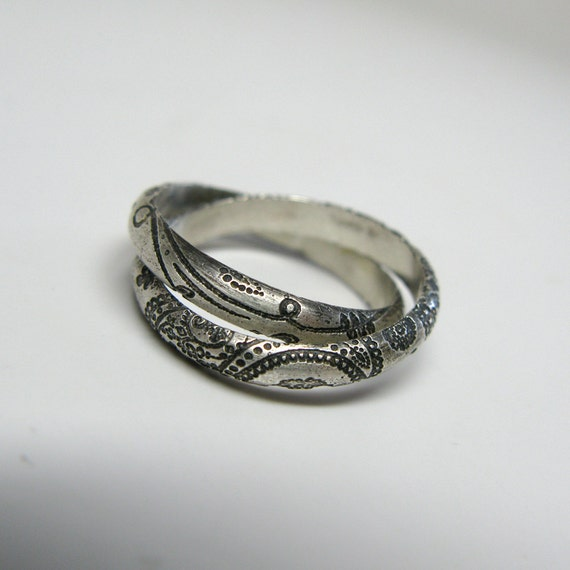 sterling silver paisley rolling ring