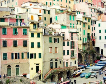 Italy photography | colorful wall art | pastel architecture | wooden boats | geometric | Italy travel photography - So Many Windows