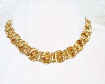Gorgeous Vintage Gold Necklace waves of Gold  wrapped. Stunning  High Polish 18 inches.High polish  ,Vintage gift under 20
