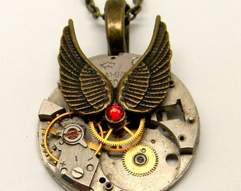 Steampunk jewelry. Steampunk watch with angel wings pendant necklace.