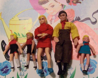 miniature family of five dolls