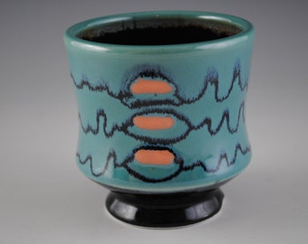 Blue,Green Porcelain Cup With Orange Spots And Black Linear Design