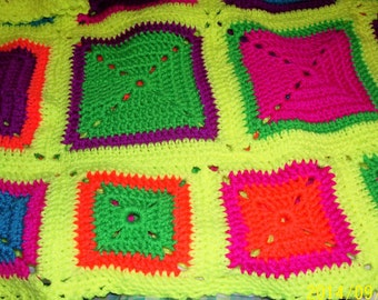 very neon hand crocheted granny square afghan