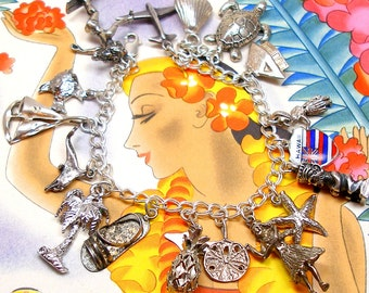 Hawaii 17 charms bracelet, Hula dancer, Tiki god, Sterling silver Hawaiian themed.
