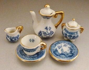 FLOW Blue DOLLHOUSE  TEA Porcelain 8 pieces white  blue scenic Gilt Edges app 1.5  in saucer