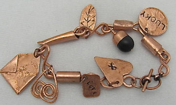 Reserved for Heeral Patel Only.   Copper Charm Bracelet. Copper bracelet.  8 charms bracelet.