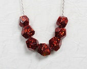 Ruby red glitter resin sparkle geometric bead necklace.