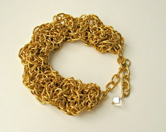 Handmade chain bracelet. Wide, faux chainmaille / chainmail. Gold toned aluminum. adjustable, one size fits most.
