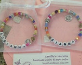 NAME bracelet on memory wire multi colored beads charms organza gift bag custom orders