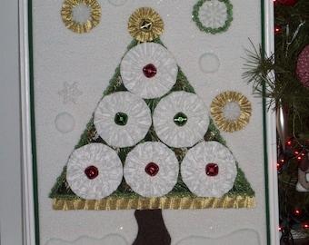Framed Jingle-Bell, Yo-Yo Christmas Tree In a Snow Storm Wall Hanging