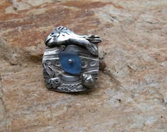Silver fish pendant with blue sea glass
