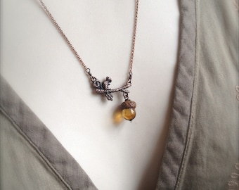 Mini Glass Acorn in Streaky Topaz with Squirrel Necklace by Bullseyebeads