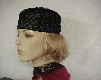 SALE.   Black straw pill box hat with decoration on top- fits small- 20 to 21 1/2