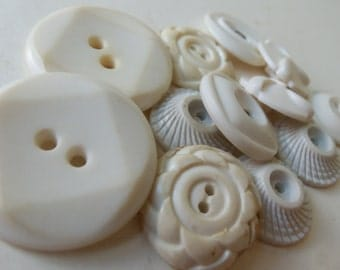 12 vintage plastic ivory white buttons