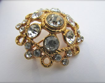 Uniquely domed vintage goldtone pin with white rhinestones