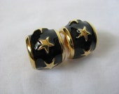 Bold black chunky vintage enamel clip on hoops with gold tone stars & trim