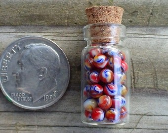 30 to 40 Miniature Glass Marbles by J. R. Hooper