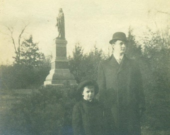Father And Son Standing With Lookout Statue Columbus Derby Hat Coats Winter Antique Black White Photo Photograph