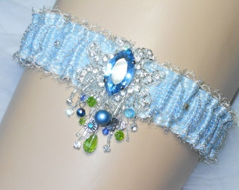 """Plus Size garter in blue satin fits thighs 18"""" to 26"""" with Silver bullion lace. HAND BEADED with water color crystals."""