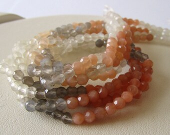Multicolor Moonstone Faceted Rounds Half Strand