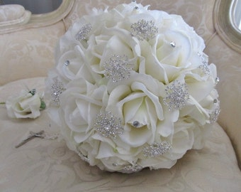 Ivory real touch rose and rhinestone brooch wedding bouquet.