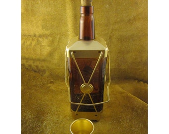 "Musical Amber & Gold Liquor Bottle Decanter Plays ""How Dry I Am"" – by Swiss Harmony"