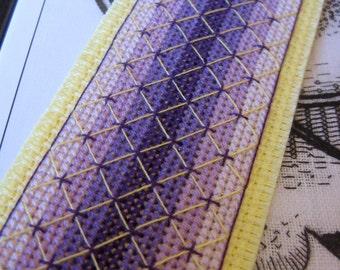 Handmade cross stitch bookmark in yellow and purple