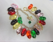 Jelly Bean charm bracelet, glass beads, red/yellow/green/purple/pink/orange, adjustable.