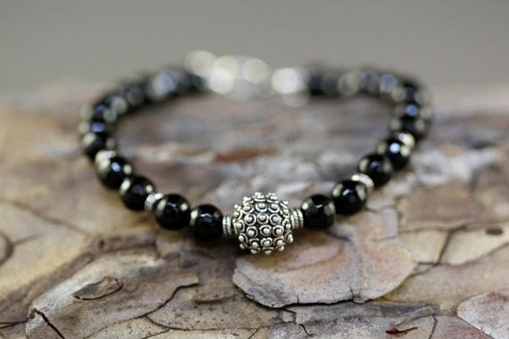 Micro-Faceted Jet Black Onyx Bracelet with a Beautifully Detailed Center Bali Bead