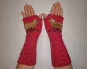 Hand-knitted pair of pink wrist warmers with hand needlecrafted sheep