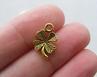 14 Four leaf clover charms antique gold tone GC10