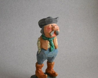 Cowboy caricature wood carving