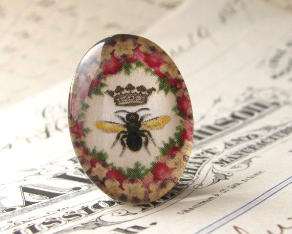 Exclusive, original artwork - Queen Bee in a floral wreath frame - handmade 25x18 mm glass oval cabochon - red, yellow, black, flower, crown