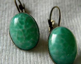 Green Marblized Oval Cabochons in Bronze Leverback Settings