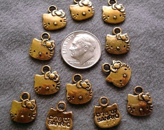 12, HELLO KITTY Jewelry Pendant Charms Antique Gold plated zinc findings CFP028