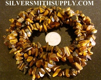 34 Inch Tiger's Eye chip bead strand small to med size nuggets 2.95 SB022