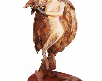 She Hawk Original Rick Cain Wood Carving Woman and Hawk Sculpture