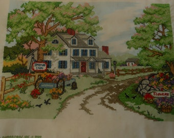 vintage finished stitchery, country inn with flower cart, unframed, 11 1/2 by 16 inches.