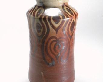 Shino glazed vase with iron slip painted organic pattern