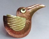 Carved copper bird brooch